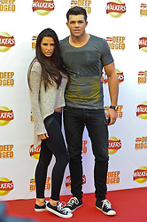 © Licensed to London News Pictures. 29/08/2012. London,UK. Katie Price (AKA Jordan) and Leandro Penna attending the launch Walkers news Deep Ridged crisps. To celebrate the launch Walkers unveiled 'Britain's Biggest Ever Crisp' standing at 22m tall .Photo credit : Thomas Campean/LNP. .