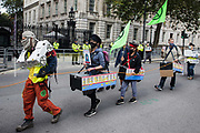 Activists from HS2 Rebellion, an umbrella campaign group comprising longstanding campaigners against the HS2 high-speed rail link as well as Extinction Rebellion activists, march along Whitehall with the handmade Boris the Bank Engine to a protest rally in Parliament Square on 4 September 2020 in London, United Kingdom. The rally, and a later protest action at the Department of Transport during which activists glued themselves to the doors and pavement outside and sprayed fake blood around the entrance, coincided with an announcement by HS2 Ltd that construction of the controversial £106bn high-speed rail link will now commence.