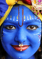 WATFORD HERTFORDSHIRE: A young girl wears makeup representing Lord Krishna. Over 55,000 pilgrims and guests visit the Largest Hindu Festival in Europe at Bhaktivedanta Manor Krishna Temple near Watford on Sunday 5th September to celebrate Janmashtami the birth of Lord Krishna. The Manor was donated to the Hare Krishna Movement in the early 1970s by former Beatle George Harrison. 03 SEPT 2010. STEPHEN SIMPSON ..