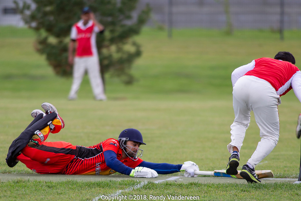 Photo Randy Vanderveen<br /> Grande Prairie, Alberta<br /> 2018-09-01<br /> A Fort McMurray batsman dives back toward the wicket to remain safe during a Saturday afternoon cricket match between Grande Prairie and Fort McMurray.
