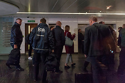 © Licensed to London News Pictures. 23/03/2018. LONDON, UK.  The UK Information Commissioner Office (ICO) staff arrive at the building which houses the offices of Cambridge Analytica in central London.  A court warrant to search the premises for evidence of any breaches of the Data Protection Act has just been obtained.  Cambridge Analytica, a UK based data consulting firm, has been accused of using the personal data of 50m Facebook users to influence the 2016 US presidential election.  Photo credit: Stephen Chung/LNP