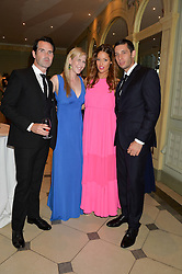 Left to right, JIMMY CARR, KAROLINE COPPING, ERIN GLEAVE and musician EXAMPLE at 'A Night of Champions' an evening to raise funds for the Mo Farah Foundation held at The Hurlingham Club, London on 28th August 2014.