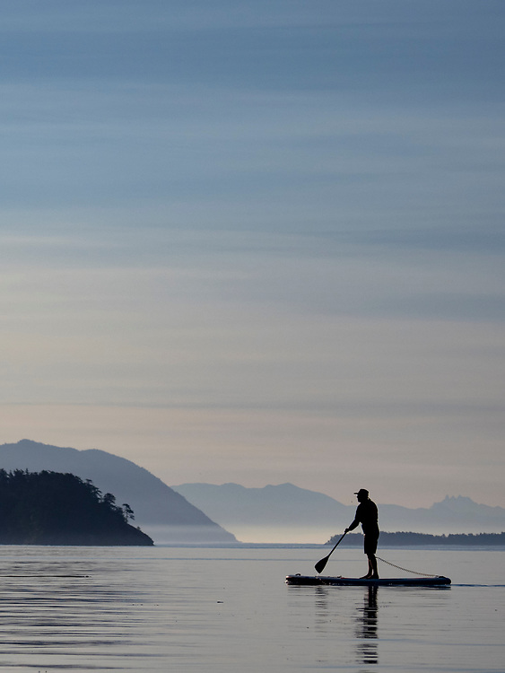 United States, Washington, San Juan Islands, stand-up paddleboarder near Sucia Island