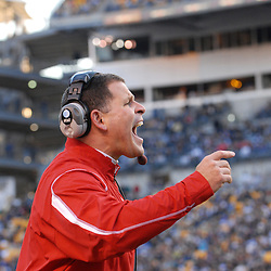 Oct 25, 2008; Pittsburgh, PA, USA; Rutgers head coach yells instructions to his defenders as they prepare for a play on their own goal line during the third quarter of Rutgers' 54-34 victory over Pittsburgh at Heinz Field.