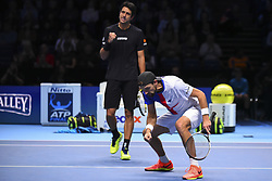 November 18, 2017 - London, England, United Kingdom - Brazil's Marcelo Melo (L) and his partner Poland's Lukasz Kubot (R) celebrate beating US player Ryan Harrison and New Zealand's Michael Venus during their men's doubles semi-final match on day seven of the ATP World Tour Finals tennis tournament at the O2 Arena in London on November 18, 2017. (Credit Image: © Alberto Pezzali/NurPhoto via ZUMA Press)