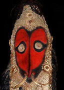 Mask in wood boar tusks and shells. Timbunke, Papua New Guinea, 1959. Ancestor mask used in ceremonies. Red is the symbol of wisdom amongst ancestors