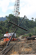 August 2012: Logs make a cross. Logging carries on unabated 24hrs a day, including lifting logs out of the Bakun reservoir. Bakun, Belaga region, Sarawak Borneo<br /> <br /> The Bakun hydro-electric dam, which covers 700km². Construction of the dam required the relocation of more than 9,000 native residents, mainly Kayan and Kenyah indigenous peoples who lived in the flooded area. Many Sarawak natives have been relocated to a longhouse settlement named Sungai Asap in Bakun. Most of them were subsistence farmers. Each family were promised only 3 acres of land, insufficient to survive, and many families still have not been compensated for the loss of their longhouses. Sarawak's primary rainforests have been systematically logged over decades, threatening the sustainable lifestyle of its indigenous peoples who relied on nomadic hunter-gathering and rotational slash & burn cultivation of small areas of forest to survive. Now only a few areas of pristine rainforest remain; for the Dayaks and Penan this spells disaster, a rapidly disappearing way of life, forced re-settlement, many becoming wage-slaves. Large and medium size tree trunks have been sawn down and dragged out by bulldozers, leaving destruction in their midst, and for the most part a primary rainforest ecosystem beyond repair. Nowadays palm oil plantations and hydro-electric dam projects cover hundreds of thousands of hectares of what was the world's oldest rainforest ecosystem which had some of the highest rates of flora and fauna endemism, species found there and nowhere else on Earth, and this deforestation has done irreparable ecological damage to that region.