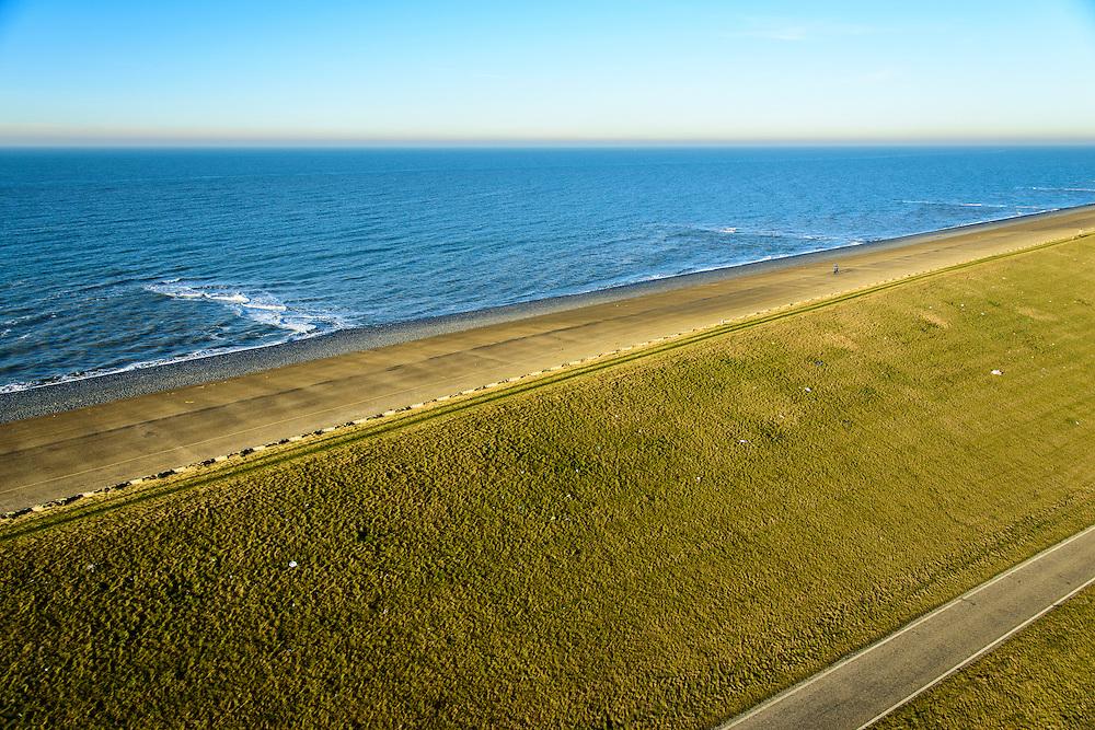 Nederland, Noord-Holland, Gemeente Schoorl, 11-12-2013; Camperduin, Hondsbossche en Pettemer Zeewering. Details van de bekleding van de dijk: steen en asfalt (bitumen) aan de zeezijde, het buitentalud, gras en klei voor de landzijde.<br /> Hondsbossche and Pettemer seawall seen to the north<br /> The dike was built as a seawall after the primal dunes were washed away. <br /> Details of the lining of the dike: concrete and asphalt (bitumen) on the seaward side, the outer slope, grass and clay on the land side.<br /> luchtfoto (toeslag op standard tarieven);<br /> aerial photo (additional fee required);<br /> copyright foto/photo Siebe Swart