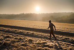 © Licensed to London News Pictures. 12/12/2017. Epsom, UK. A runner braves the frosty weather on Epsom Downs after a night of freezing sub zero temperatures. Photo credit: Peter Macdiarmid/LNP