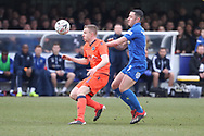 AFC Wimbledon midfielder Anthony Hartigan (8) battles for possession with Millwall midfielder Shane Ferguson (11) during the The FA Cup 5th round match between AFC Wimbledon and Millwall at the Cherry Red Records Stadium, Kingston, England on 16 February 2019.