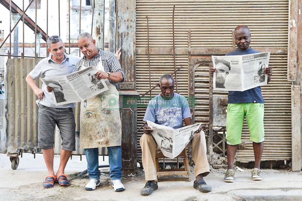 November 27, 2016 - Havana, Cuba - People read the latest newspapers, a scene from a daily life in Havana on November 26, 2016, the next day after Fidel Castro, Cuba's historic revolutionary leader, and the former Prime Minister and President of Cuba, dies on the late night of November 25, 2016, at age of 90. . Fidel Castro died aged 90. One of the world's longest-serving rulers and modern history's most singular characters, Castro defied 11 US administrations and hundreds of assassination attempts..On Saturday, 25 November 2016, in Havana, Cuba. (Credit Image: © Artur Widak/NurPhoto via ZUMA Press)