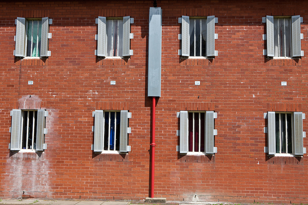 The barred cell windows of one of the wings. HMP The Mount, Bovingdon, Hertfordshire