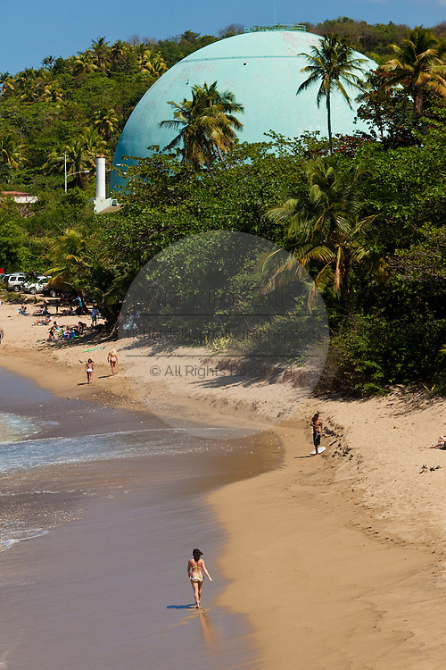 The beach and former nuclear power plant at Playa Domes Rincon Puerto Rico