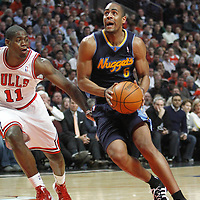 26 March 2012: Denver Nuggets shooting guard Arron Afflalo (6) drives past Chicago Bulls shooting guard Ronnie Brewer (11) during the Denver Nuggets 108-91 victory over the Chicago Bulls at the United Center, Chicago, Illinois, USA. NOTE TO USER: User expressly acknowledges and agrees that, by downloading and or using this photograph, User is consenting to the terms and conditions of the Getty Images License Agreement. Mandatory Credit: 2012 NBAE (Photo by Chris Elise/NBAE via Getty Images)