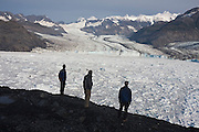 Photographer James Balog (l-r) and Adam LeWinter, of the Extreme Ice Survey, and University of Colorado glaciologist Tad Pfeffer (m), stand around camp looking out over the terminus of the Columbia Glacier, near Valdez, Alaska.