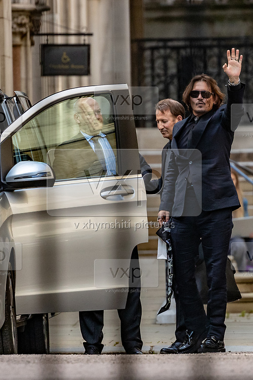 American actor Johnny Depp wave as he leaves the High Court in London, Monday, July 20, 2020. Amber Heard started Monday to give evidence at the High Court in London as part of Johnny Depp's libel case against The Sun over allegations of domestic violence during the couple's relationship. (VXP Photo/ Vudi Xhymshiti)
