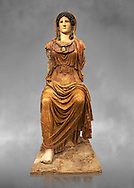 Roman statue of Athena (Roman Minerva) Sitting - from the Augustan period circa 63-43 BC the statue is a copy of a  5th century BC Greek  original, found in a palace on the Via Marmorato off the piazza dell'Emporio, Rome. The statue represents the goddess Minerva, dressed in chiton and himation which covers her head. The face and neck, now lost, have been substituted by a plaster cast of the Athena Carpegna. The aegis with the gorge emblem on her breast have enabled the goddess to be identified as Athena, the Roman Minerva, genially depicted in the guise of a helmeted female warrior. Its remarkable size suggests that this was a cult image, although a hypothesis remains linking it to the temple of Minerva on the Aventine. The sculpture bears the hallmark of a second of the 5th century BC Hellenistic Greek statue  made by Phidias. but uses different materials from the original which would have been in gold and ivory .National Roman Museum, Rome, Italy