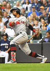 May 8, 2018 - Milwaukee, WI, U.S. - MILWAUKEE, WI - MAY 08: Cleveland Indians Shortstop Francisco Lindor (12) makes contact during a MLB game between the Milwaukee Brewers and Cleveland Indians on May 8, 2018 at Miller Park in Milwaukee, WI. The Brewers defeated the Indians 3-2.(Photo by Nick Wosika/Icon Sportswire) (Credit Image: © Nick Wosika/Icon SMI via ZUMA Press)
