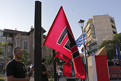 June 25, 2017 - Thessaloniki, Greece - Hundreds of supporters of the nationalist Golden Dawn party held a torch-lit march in Thessaloniki, Greece on 25 June 2017, to protest against the Greek government's stance on the Macedonia naming dispute. Before the march there were held some speeches from parliament members of Golden Dawn, like Ioannis Lagos from Pireaus. They mentioned that the Greek Government is seeking for the name for FYROM as Macedonia of Vardar. Afterwards was a march that was peaceful. About 150 anarchists tried to get closer to this rally but strong police forces didn't allow them to get closer. (Credit Image: © Nicolas Economou/NurPhoto via ZUMA Press)
