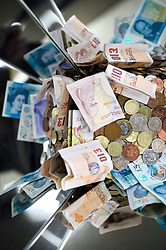 UK bank notes and coins of various denominations. Picture date: Thursday March 2nd, 2017. Photo credit should read: Matt Crossick/ EMPICS Entertainment.