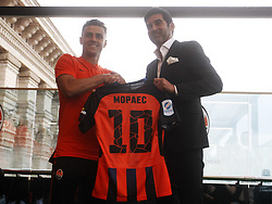 July 17, 2018 - Kiev, Ukraine - JUNIOR MORAES (L) holds up a Shakhtar Donetsk shirt and shakes hand with head coach PAULO FONSECA (R) during of his official presentation in Kiev, Ukraine, on 17 July 2018. (Credit Image: © Serg Glovny via ZUMA Wire)
