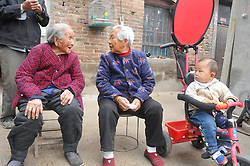 October 8, 2016 - Anyang, Anyang, China - Anyang, CHINA-October 8 2016: (EDITORIAL USE ONLY. CHINA OUT) Ma Chunhuan, a 103-year-old woman, talks with her neighbor in Siyangzhuang Village, Neihuang County, Anyang, central China¡¯s Henan Province, October 8th, 2016. Although Ma Chunhuan is 103 years old, she can do needle work flexibly and use cell phone easily. (Credit Image: © SIPA Asia via ZUMA Wire)