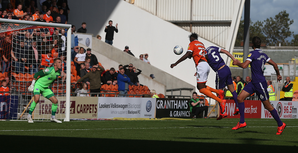 Blackpool's Armand Gnanduillet beats Portsmouth's Paul Downing to the ball and scores his side's equalising goal to make the score 1-1<br /> <br /> Photographer Stephen White/CameraSport<br /> <br /> The EFL Sky Bet League One - Blackpool v Portsmouth - Saturday 31st August 2019 - Bloomfield Road - Blackpool<br /> <br /> World Copyright © 2019 CameraSport. All rights reserved. 43 Linden Ave. Countesthorpe. Leicester. England. LE8 5PG - Tel: +44 (0) 116 277 4147 - admin@camerasport.com - www.camerasport.com