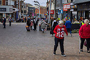 Women wearing unseasonal Christmas jumper walking along the high street, 21st April 2021 in Blackpool, Lancashire, United Kingdom. Blackpool is a large town and seaside resort in the county of Lancashire on the north west coast of England. Blackpool was once a booming resort with it's famous promenade which now, despite having a somewhat shabby appearance, still continues to attract millions of visitors each year. During the coronavirus pandemic however, Blackpool has struggled, with empty streets and closed down businesses creating an atmosphere more like a ghost town.