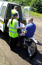 A motorcyclist is issued with nois abatement orders during a police operation against illegal off road biking in the High Green area Sunday <br /><br />Image Copyright Paul David Drabble<br /><br />29 June 2003<br /><br />Copyright  Paul David Drabble<br /><br />[#Beginning of Shooting Data Section]<br />Nikon D1 <br /><br />2003/06/29 09:51:53.6<br /><br />JPEG (8-bit) Fine<br /><br />Image Size:  2000 x 1312<br /><br />Color<br /><br />Lens: 24mm f/2.8<br /><br />Focal Length: 24mm<br /><br />Exposure Mode: Programmed Auto<br /><br />Metering Mode: Multi-Pattern<br /><br />1/250 sec - f/7.6<br /><br />Exposure Comp.: