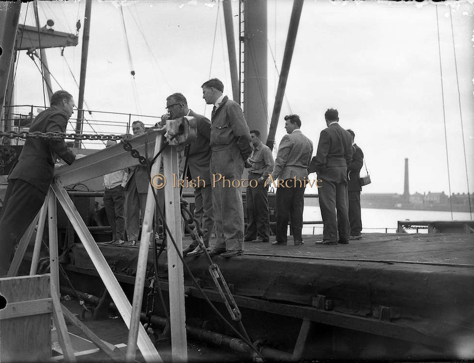 31/07/1962<br /> 07/31/1962<br /> 31 July 1962<br /> Oil drilling equipment arrives in Dublin. Equipment to be used in the drilling of the 1st exploratory oil well at Rathmolyon, Trim, Co. Meath, arrived in Dublin by ship from Texas. Picture shows Mr David T. Kiester, Operations Manager, Ambassador Irish Oil Co.; Mr Calvin Galyen, Drilling Co.; Mr G. Stewart, Tool Pusher and Mr John Warren, Air Drilling Supervisor, inspecting some  of the equipment.