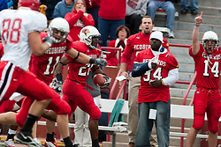 08 Oct 2005  Ryan Hoffman goes wild on the sidelines as Rafeal Rice speeds left past the last blocker on his way to the endzone.  The Illinois State University Redbirds roped and tied the Western Kentucky University Hilltoppers in regulation but loosened the noose in Overtime as the Hilltoppers take the honors with a 37 - 24 Victory in Gateway Conference action at Hancock Stadium on Illinois State's campus in Normal IL.