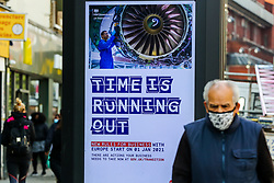 © Licensed to London News Pictures. 19/10/2020. London, UK. A man in north London walks past the government's publicity campaign 'TIME IS RUNNING OUT' for firms that trade with Europe to prepare for a no-deal Brexit. HMRC will contact over 200,000 firms that trade with the EU to set out the new customs and tax rules and how to deal with them. Photo credit: Dinendra Haria/LNP