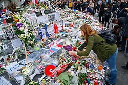 © Licensed to London News Pictures. 17/11/2015. Paris, France. Mourners visit a memorial at Place de la Republique in Paris, France following the Paris terror attacks on Tuesday, 17 November 2015. Photo credit: Tolga Akmen/LNP