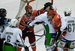 Andrej Hebar of Jesenice vs Travis Brigley of Olimpija at 14th Round of EBEL league  ice hockey match between HK Acroni Jesenice and HDD Tilia Olimpija Ljubljana, on October 16, 2009, in Arena Podmezaklja, Jesenice. (Photo by Vid Ponikvar / Sportida)