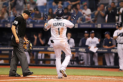 May 22, 2018 - St. Petersburg, FL, U.S. - ST. PETERSBURG, FL - MAY 22: Willy Adames (1) of the Rays steps on home plate and raises his hands to the heavens as he makes his Major League Debut this evening and in his second at bat, hits a home run off of Chris Sale of the Red Sox during the MLB regular season game between the Boston Red Sox and the Tampa Bay Rays on May 22, 2018, at Tropicana Field in St. Petersburg, FL. (Photo by Cliff Welch/Icon Sportswire) (Credit Image: © Cliff Welch/Icon SMI via ZUMA Press)