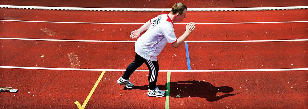 Nederland, Den Bosch, 02-06-2012.<br /> Special Olympics, Spelen voor geestelijk gehandicapten.<br /> 400 meter, mannen. Start zonder startblok.<br /> Foto : Klaas Jan van der Weij