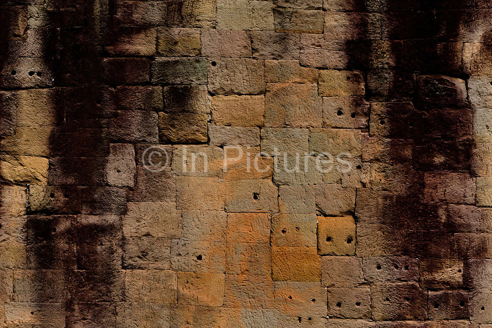 Unmortered stones set as part of the wall in the Bayon Temple, Ankor.