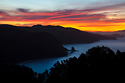 A fiery sunrise colors the sky over Muir Beach in the Golden Gate National Recreation Area near San Francisco, California. This scene was captured from the Muir Beach Overlook trail.