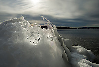 Frozen chunks of ice on the shore of Lake Winnisquam off Gale Ave in Laconia gives the feel of the Arctic as temperatures dipped to below zero on Thursday morning.  (Karen Bobotas/for the Laconia Daily Sun)