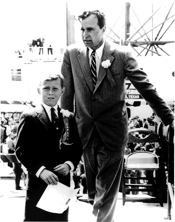 H049-02     George W. Bush with his father, George H. Bush, at the commissioning ceremonies for the Scorpion off-shore drilling platform, 20 Mar 56.<br /> Photo Credit:  George Bush Presidential Library