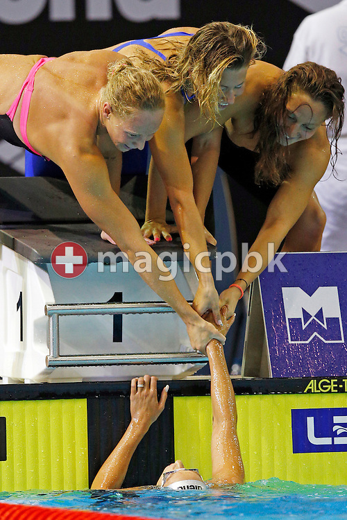(Top L-R) Chiara MASINI LUCCETTI, Stefania PIROZZI and Alice MIZZAU of Italy congratulate her teammate Federica Pellegrini after she touched first in the women's 4x200m Freestyle Relay Final during the LEN European Swimming Championships at Europa-Sportpark in Berlin, Germany, Thursday, Aug. 21, 2014. (Photo by Patrick B. Kraemer / MAGICPBK)