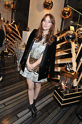 ANGELA SCANLON at a party to celebrate the launch of a limited edition shoe The Chambord in celebration of Nicholas Kirkwood's partnership with Chambord black raspberry liqueur, held at the Nicholas Kirkwood Boutique, 5 Mount Street, London on 12th December 2012.