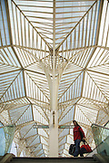 A man carrying bags at Oriente Station. The station was projected by spanish architect Santiago Calatrava and was inaugurated for the Expo98 world exhibition in Lisbon.