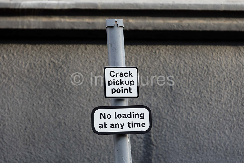 Community activists from the 'Columbia Road Cartel' erect hoax 'Crack Pickup Point' road signs as part of the anti drugs street art campaign in residential streets near Columbia Road in Shoreditch east London on September 16, 2018 to highlight high levels of drug dealing in this part of Tower Hamlets, where the cheapest heroin in Europe can allegedly be purchased. The road signs and markings were commissioned by residents from the Weavers Community Action Group who claim that the police and Tower Hamlets Council are failing to address the growing drugs problem in the area.  (photo by Vickie Flores / In Pictures via Getty Images)
