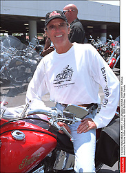 File photo - © Lionel Hahn/ABACA. 26941-7. Los Angeles-CA-USA. 03/07/2001. Famous motorcyle factory Indian celebrates its 100th birthday. Peter Fonda. Peter Fonda, the star, co-writer and producer of the 1969 cult classic Easy Rider, has died at the age of 79. Peter Fonda was part of a veteran Hollywood family. As well as being the brother of Jane Fonda, he was also the son of actor Henry Fonda, and father to Bridget, also an actor.