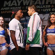 Boxers J'Leon Love (left) and Marco Antonio Periaban face off during the undercard final press conference for the Mayweather & Maidana boxing match at the Hollywood Theater, inside the MGM Grand hotel on Thursday, May 1, 2014 in Las Vegas, Nevada.  (AP Photo/Alex Menendez)