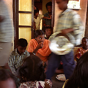 Children orphaned by the tsunami eat at an orphanage in Nagappattinam, on the southeastern coast of India. In the centre sits Nirmala Kunjibabu, 15, whom despite her lost of her mother continued to thrive at school..The December 26, 2004 tsunami killed thousands of people along this coast, smashing boats, roads and houses and tearing thousands of families apart. .Picture taken February 2005 in Nagapptinam, Tamil Nadu, India, by Justin Jin
