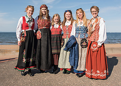 Norway celebrates its independence on May 17 every year. Across the world Norwegians dress up in distinctive regional costumes to celebrate. Anne Marte Bergseng and her daughters and friends have made it a tradition to go down to the beach and walk along the Promenade in Portobello after returning home from the city parade at The Mound.