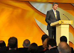 © Licensed to London News Pictures. 21/09/2011. BIRMINGHAM, UK.    Michael Moore Secretary of State for Scotland delivers a speech at the Liberal Democrat Conference at the Birmingham ICC today (21 Sept 2011): Stephen Simpson/LNP . Photo credit : Stephen Simpson/LNP