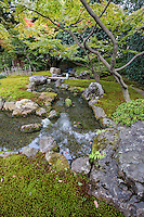"""Rakusuien Garden at Jonangu Shrine is rarely seen by visitors - partly because the buildings are fairly new, having been rebuilt in the 70s after being destroyed by fire. Nevertheless, its magnificent Rakusuien Garden is an island of tranquility when compared with the hubbub of the more famous gardens in Kyoto.  Hara no Yama Garden is rather austere, consisting of a winding path that goes past a stone lantern and waterway.  Heisei Garden is composed of a large pond with an island making much use of borrowed scenery from the forest behind and its own waterfall.  Muromachi Garden has its own small pond and an adjacent teahouse, with a large field behind it with artistically sculpted shrubs.  The path leads into Momoyama Garden, with weeping cherry trees.  Lastly there is a dry rock karesansui garden, Jonan Rikyu, though it cannot be called a """"Zen Garden"""" because it is within a Shinto Shrine compound, rather than a Zen Buddhist temple."""